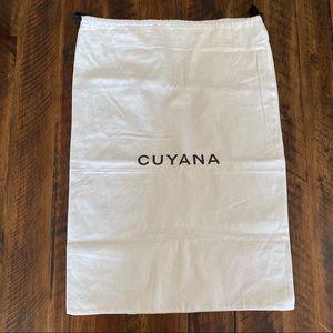 Two Cuyana dust bags